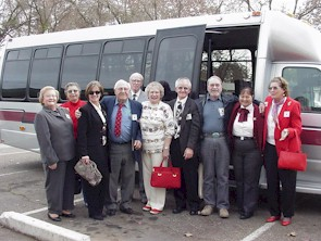 Group of people standing in front of the transportation bus.